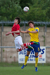 FLINT, WALES - Thursday, May 12, 2011: Wales' Jaye Bowen in action against Sweden's captain Melker Hallberg during the Men's Under-17's International Friendly match at Cae-y-Castell. (Photo by David Rawcliffe/Propaganda)