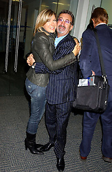 TV presenter PENNY SMITH and EDDIE JORDAN at the annual ICAP charity day - where all the trading profit made by City firm ICAP are donated to charity, held at their offices at 2 Broadgate, City of London on 7th December 2005.<br />