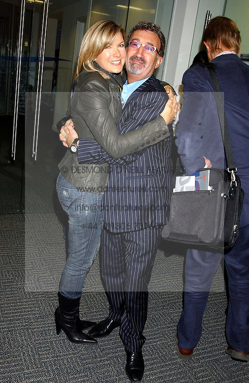 TV presenter PENNY SMITH and EDDIE JORDAN at the annual ICAP charity day - where all the trading profit made by City firm ICAP are donated to charity, held at their offices at 2 Broadgate, City of London on 7th December 2005.<br /><br />NON EXCLUSIVE - WORLD RIGHTS