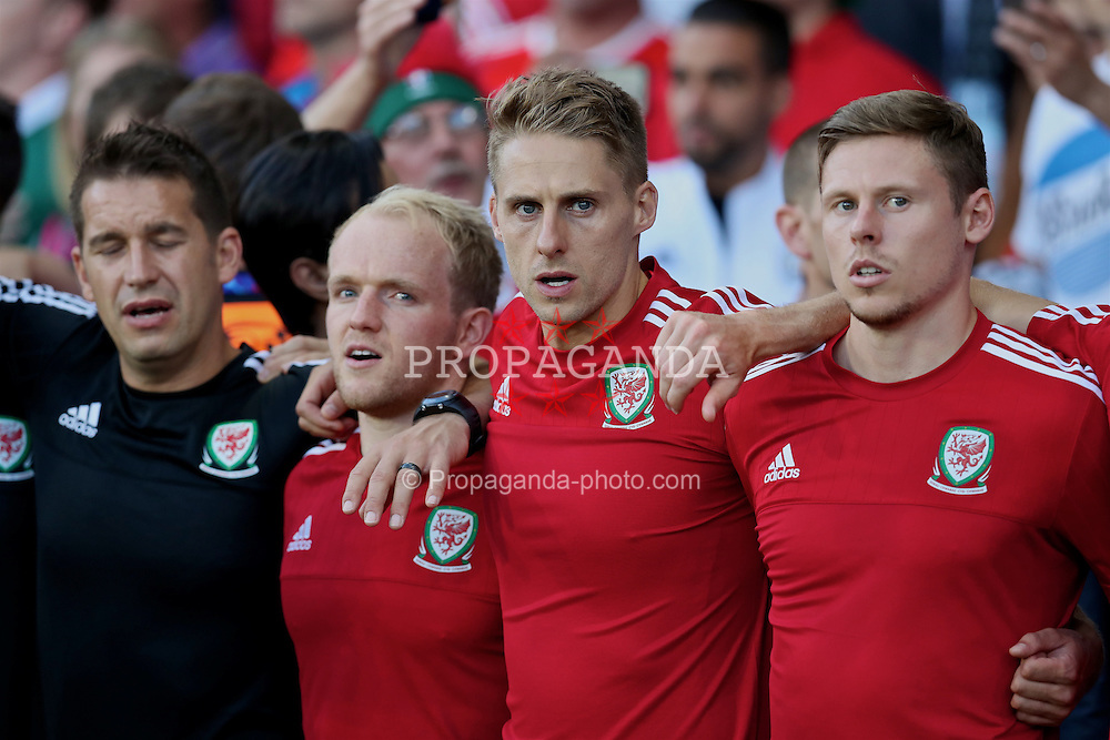 TOULOUSE, FRANCE - Monday, June 20, 2016: Wales' substitutes Jonathan Williams, David Edwards and Simon Church sing the national anthem before the final Group B UEFA Euro 2016 Championship match against Russia at Stadium de Toulouse. (Pic by David Rawcliffe/Propaganda)