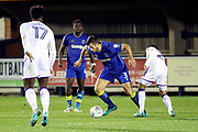 AFC Wimbledon defender Jon Meades (3) dribbling during the EFL Trophy match between AFC Wimbledon and Luton Town at the Cherry Red Records Stadium, Kingston, England on 31 October 2017. Photo by Matthew Redman.