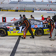 The Stewart-Haas Racing team returns Tony Stewart (14) racing car to the garage after SPRINT CUP SERIES FEDEX 400 BENEFITING AUTISM SPEAKS auto race at Dover International Speedway in Dover, DE., Sunday,  June 02, 2013.