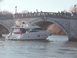 """LNP Weekly Highlights 21/03/14 © Licensed to London News Pictures. 16/03/2014. Richmond, UK The pleasure cruiser """"The Victoria"""" crashes into Richmond Bridge in surrey today 16th March. There was considerable damage to the vessel. The boat eventually made it through the bridge to cheers from crowds who were enjoying the sunny weather along the River Thames. . Photo credit : Michael Traboulsi/LNP"""
