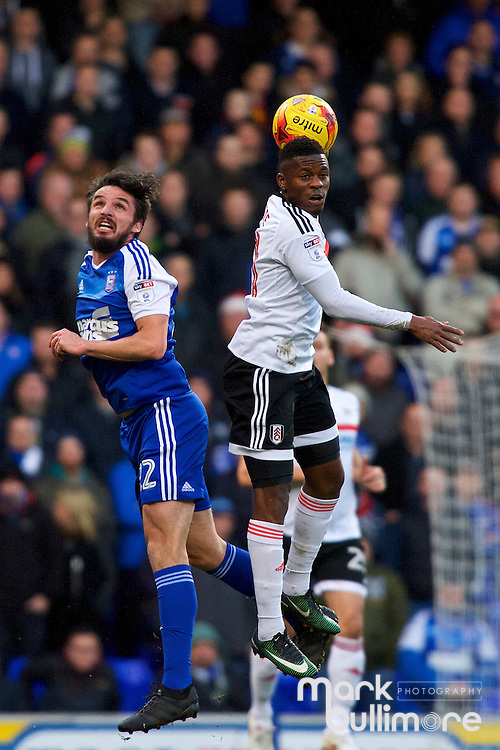 Ipswich, Suffolk. Football action from Ipswich Town v Fulham at Portman Road in the Sky Bet Championship on the 26th December 2016. Ipswich Jonathan Douglas  and Fulham's Sone Aluko.<br /> <br /> Picture: MARK BULLIMORE