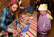 Kirsten Hansen, 13 of Centerville (left) in the historic Smith home in Bill Yeck Park, part of the Centerville-Washington Township Park District, Friday, December 17, 2010.  The Smith house had hot chocolate and music for those on the Holiday Stroll and luminaria walk.