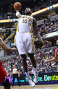 March 14, 2012; Indianapolis, IN, USA; Indiana Pacers center Roy Hibbert (55) attempts a dunk against the Philadelphia 76ers at Bankers Life Fieldhouse. Indiana defeated Philadelphia 111-94. Mandatory credit: Michael Hickey-US PRESSWIRE