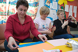 Women learning at adult education college,
