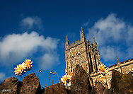 The Church know as Great Malvern Priory, was taken on a weekend photography trip away in Great Malvern. The Church now a Local Parish church was originally constructed as Benedictine Monastery circ 1075. This was my favourite composition. As any honest photographer will tell you it took me a whole bunch of exposures to get the composition, lighting and focus how i wanted it. Clearly i wanted to keep the fabulous detail and colour in the masonary but also get the flowers in somes sort of focus, while losing some of the focus in the rock. A kind of falling off in detail if you like. From a technical point of view , especially as it was a very light day and still needing a mid range depth of field, a very fast shutter was required, combined with using the right light metering mode.  There was a little post production just to really bring out the tones and etail in the stone work.