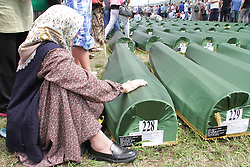 60113380  <br /> An old woman sits next to a small coffin in Srebrenica, Bosnia and Herzegovina, July 11, 2013. Thousands of in Bosnia and Herzegovina gathered on Thursday at Potocari Memorial Centre near Srebrenica to mourn for victims in the 1995 Srebrenica Massacre. A total of 409 newly-identified victims were buried at the centre on the 18th anniversary of the massacre, putting the numbers of gravestones to over 6000, picture taken Thursday, July 11, 2013.<br /> Photo by imago / i-Images<br /> UK ONLY