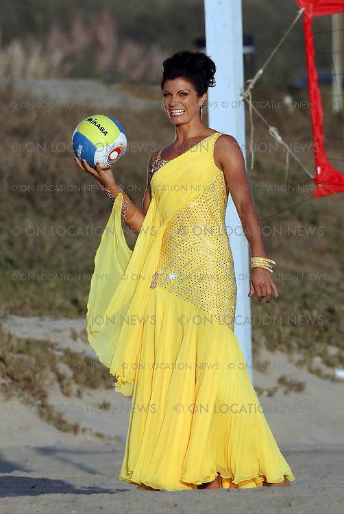 SANTA MONICA, CALIFORNIA - THURSDAY 4TH SEPTEMBER 2008. ***EXCLUSIVE*** Misty May-Treanor shows off her Volleyball skills while wearing her dancing gown as she filmed a  video segment for the new season of 'Dancing With The Stars'. Beach Volleyball champion Misty May-Treanor captured her second Olympic gold medal at the 2008 Beijing Summer Olympics. Photograph: On Location News. Sales: Eric Ford 1/818-613-3955