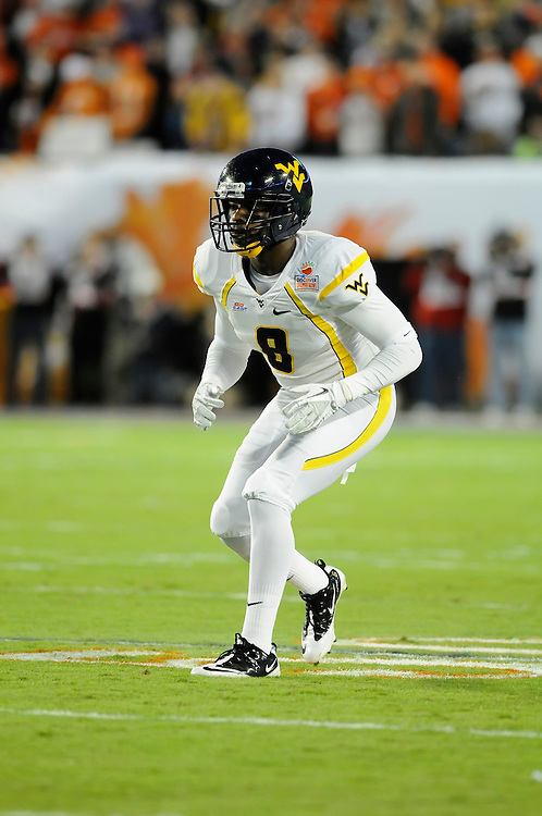 January 4, 2012: Keith Tandy #8 of West Virginia in action during the NCAA football game between the West Virginia Mountaineers and the Clemson Tigers at the 2012 Discover Orange Bowl at Sun Life Stadium in Miami Gardens, Florida.