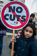 Maryam, aged 7, is against fire station closures, having befriended the firemen at the Westminster station, which has now closed. A Budget Day  protest against cuts and austerity is supported by Caroline Lucas, Green Party, the PCS union, CND and various student bodies.  At the same time a petition is handed in to Downing Street. Opposite Downing Street in Whitehall, London, UK 19 March 2014.  Guy Bell, 07771 786236, guy@gbphotos.com