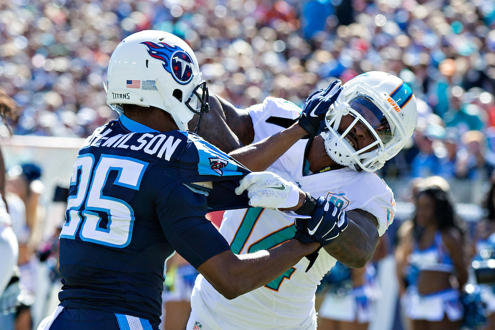 NASHVILLE, TN - OCTOBER 18:  Jarvis Landry #14 of the Miami Dolphins gets in a shoving match with Blidi Wreh-Wilson #25 of the Tennessee Titans at LP Field on October 18, 2015 in Nashville, Tennessee.  The Dolphins defeated the Titans 38-10.  (Photo by Wesley Hitt/Getty Images) *** Local Caption *** Jarvis Landry; Blidi Wreh-WIlson