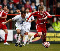 Photo: Richard Lane/Richard Lane Photography. Swindon Town v Norwich City. Coca-Cola Football League One. 20/03/2010. Norwich's Darel Russell and Swindon's Danny Ward (rt) challenge for the ball.