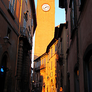 Shaft of morning sunlight illuminates Palazzo dei Signori Sette e Torre Del Moro, Orvieto, Italy<br />