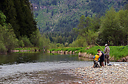 The Conrow family fishing along the Bull River at the Bull River Guard Station, one of the original ranger stations in the Kootenai National Forest now used as a rental cabin. Bull River Valley, northwest Montana.