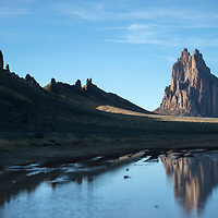 The Shiprock Pinnacle is reflected in a puddle on the east side of the dyke in Shiprock Wednesday.