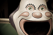 A garbage receptacle in the form of a wide-mouth clown encourages visitors to keep the grounds clean at the Pacific National Exhibition in Vancouver, British Columbia.