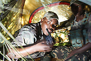 Nkwe wildlife security services offer a paramilitary - style rhino protection service that operates in the several private game reserves in the Limpopo area of South Africa..Nkwe's recruits undergo a basic two week training program focusing on military discipline and endurance to become a field ranger. From this stage the field rangers may be selected for an advance course that focuses on firearms and tactical training. Once this is completed they will be given rank and go on armed patrol to protect the rhinos...Pic shows: Qualified Corporal Evans Maluleke uses his radio to communicate to nearby Nkwe security..Decent communications are key in the battle against rhino poachers...Nkwe Wildlife Security Services based in the Lapalala Wilderness Area, Limpopo, South Africa...© Zute Lightfoot