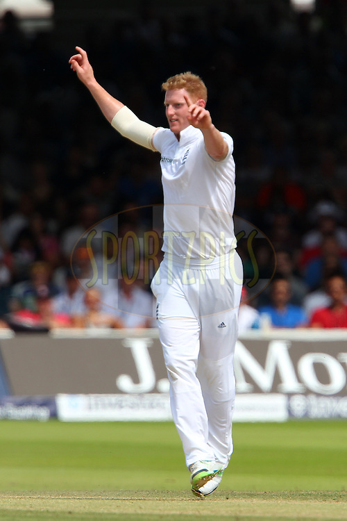 Ben Stokes of England celebrates the wicket of Shikhar Dhawan of India during day three of the 2nd Investec test match between England and India held at Lords cricket ground in London, England on the 19th July 2014<br /> <br /> Photo by Ron Gaunt / SPORTZPICS/ BCCI