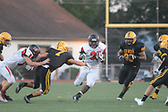 Hatboro Horsham's Josh Smith runs with the football as Central Bucks West defenders give chase in the first quarter at Central Bucks West High School Friday August 26, 2016 in Doylestown, Pennsylvania.  (Photo by William Thomas Cain)