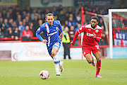 Gillingham's Bradley Dack advances upfield being chased by Crawley Town's Gavin Tomlin during the Sky Bet League 1 match between Crawley Town and Gillingham at the Checkatrade.com Stadium, Crawley, England on 28 March 2015. Photo by Geoff Penn.