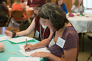 Rachel Cornish fills out paper work with her mentee during the Women's Mentoring Meet and Greet event on Sept. 4, 2018 in Walter Rotunda. Photo by Hannah Ruhoff