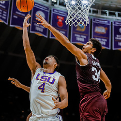 Jan 23, 2018; Baton Rouge, LA, USA; LSU Tigers guard Skylar Mays (4) shoots over Texas A&M Aggies center Tyler Davis (34) during the second half at the Pete Maravich Assembly Center. LSU defeated Texas A&M 77-65. Mandatory Credit: Derick E. Hingle-USA TODAY Sports