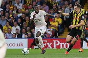 Manchester United Midfielder Paul Pogba battles with Watford defender Craig Cathcart (15) during the Premier League match between Watford and Manchester United at Vicarage Road, Watford, England on 15 September 2018.