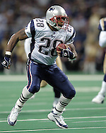 New England Patriots running back Corey Dillon looks for running room against the St. Louis Rams at the Edward Jones Dome in St. Louis, Missouri, November 7, 2004.