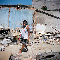 Long-time resident of 30-years, Maria Estele, of Largo do Tanque, walks through what is left her home after demolition, in Rio de Janeiro, Brazil, on Monday, Feb. 25, 2013. The city gave her $7,000 usd in compensation, not nearly enough to buy a new house.<br />
