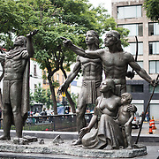 A statue of a set of pre-colonial figures in Centro Historico, Mexico City.