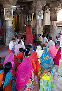 People praying at a temple in Udaipur, Rajasthan, India