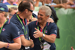 Ferdi Eilberg, father of Michael is congratulated by Team GBR Chef d'Equipe Richard Waygood  - Freestyle Grand Prix Dressage - Alltech FEI World Equestrian Games™ 2014 - Normandy, France.<br /> © Hippo Foto Team - Jon Stroud<br /> 25/06/14