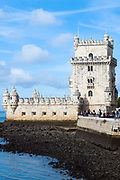 Tourists visit Belem Tower - the Tower of Saint Vincent is a 16th-century fortification and gateway to Lisbon, Portugal