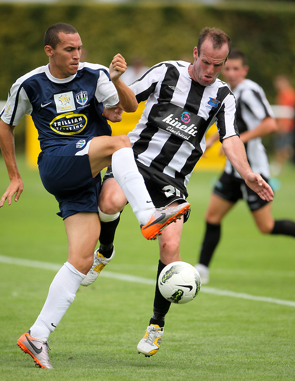Hawkes Bay United's Leon Birnie (R) and Auckland City's Angel Berlanga contest a ball in the teams ASB Premiership Football match at Park Island, Napier, New Zealand, 06 February 2012, Photo: SNPA / John Cowpland