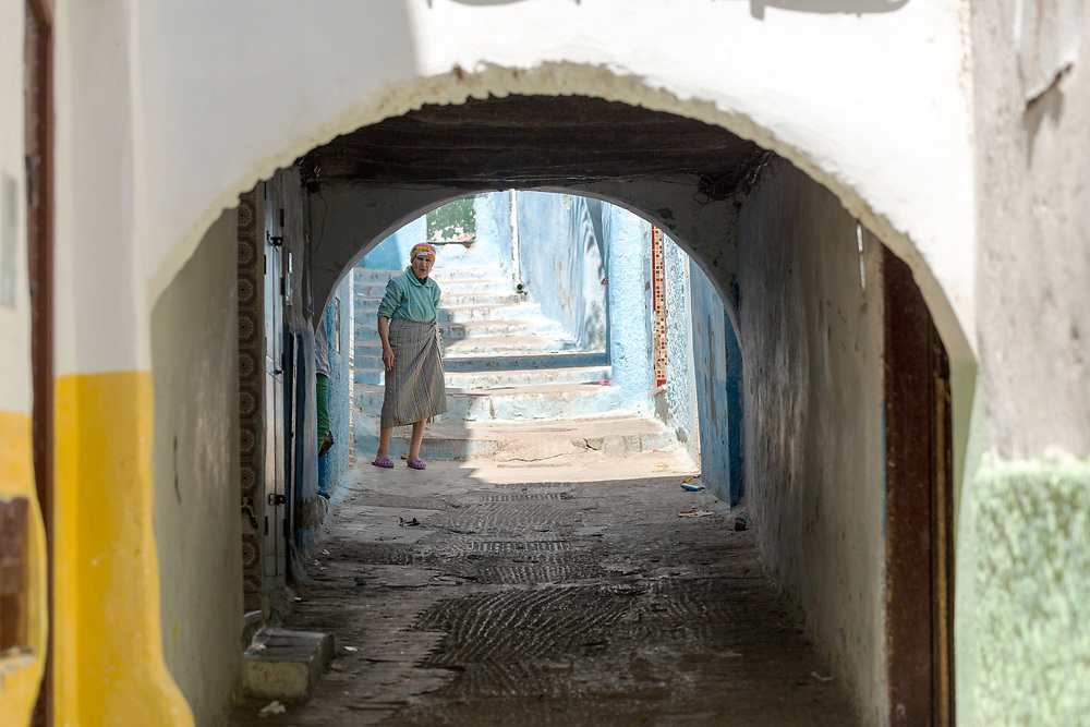 TETOUAN, MOROCCO - 6th April 2016 - Elderly Amazigh women stands outside her home in the Tetouan Medina, Rif region of Northern Morocco.