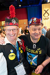 Edinburgh, Scotland, UK. 27 April, 2019. SNP ( Scottish National Party) Spring Conference takes place at the EICC ( Edinburgh International Conference Centre) in Edinburgh. Pictured; Delegates in tartan enjoying proceedings of the conference on day one.