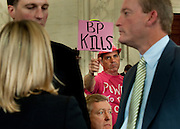 May 11,2010 - Washington, District of Columbia USA - Tighe Barry, with Code Pink, shows his disdain for BP during  a .Senate Energy and Natural Resources Committee hearing on the accident in the Gulf of Mexico involving the offshore oil rig Deepwater Horizon.(Credit Image: © Pete Marovich/ZUMA Press)