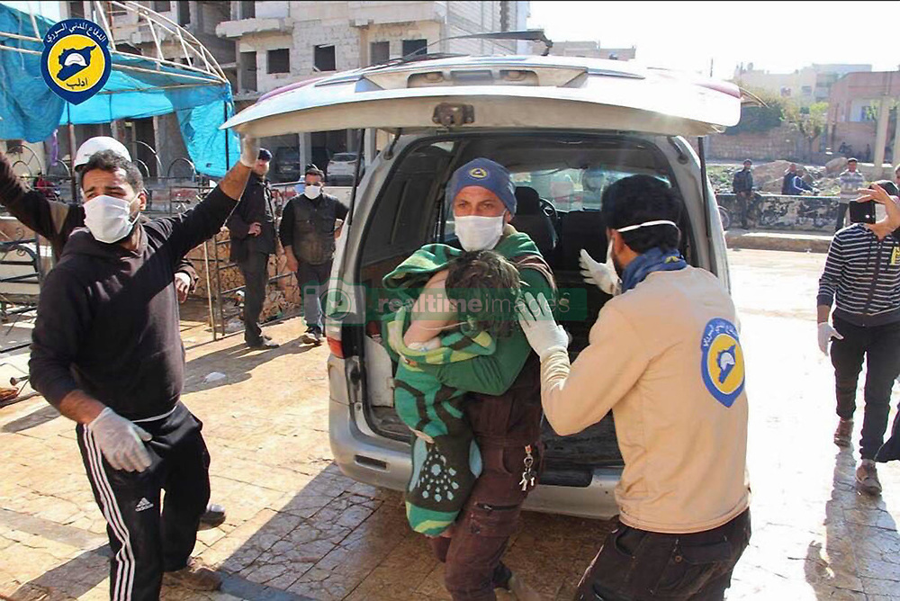 April 4, 2017 - Khan Sheikhoun, Idhib Province, Syria - Syrian Civil Defense aka the White Helmets, helping victims after morning attack of a suspected serious lethal gas (most likely sarin nerve gas), in rebel-held Idlib Province in northwestern Syria, near Turkey (population 165,000). A score wounded and over dozen already dead, others might die shortly as a after effect of exposure to deadly gases. The inhabitants are overwhelmingly Sunni Muslims, although there is a significant Christian minority. (Credit Image: © Syria Civil Defence via ZUMA Wire).
