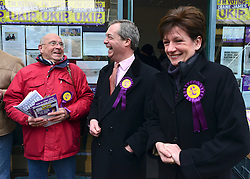 © Licensed to London News Pictures. 27/02/2013. Eastleigh, UK UKIP leader Nigel Farage (centre) and UKIP candidate Diane James (right)campaign in Eastleigh town centre today 27th February 2013. Voting in the Eastleigh by-election takes place tomorrow (28/02/13). Photo credit : Stephen Simpson/LNP