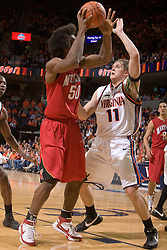 Virginia forward Laurynas Mikalauskas (11) guards Maryland forward Bambale Osby (50).  The Virginia Cavaliers defeated the Maryland Terrapins 91-76 at the University of Virginia's John Paul Jones Arena  in Charlottesville, VA on March 9, 2008.