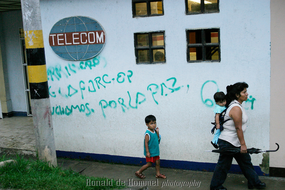 The walls of Toribio's houses are covered in graffiti. Most messages are against the government and promoting FARC like this one: translation: FARC/EP fights for peace. ..Toribio is a small town, capital of the mountainous region with the same name, in central Cauca Province. The area is an indigenous reserve for the Nasa indians and is governed by traditional tribal law. The indians are stuck in the middle between the permanent presence of several FARC camps and contingents of the governement army.  2003 Cauca province, southern Colombia
