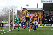 Cambridge No 8 and captain Luke Berry gets in a header in the Sky Bet League 2 match between Cambridge United and Carlisle United at the R Costings Abbey Stadium, Cambridge, England on 16 April 2016. Photo by Nigel Cole.