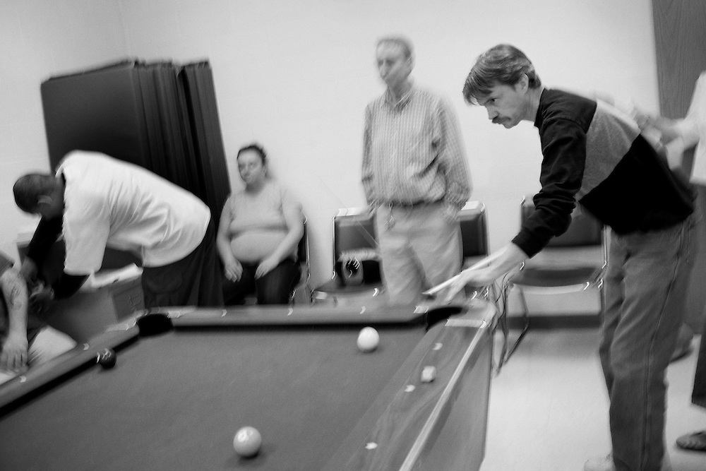 William Sorrell plays pool with other patients at Maryhaven, a healthcare facility specializing in treatment for people with alcohol and drug dependencies in Columbus, Ohio on Tuesday, April 21, 2009. Patients are kept on a very regimented schedule which includes time for recreational activities.