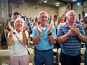 """15 JUNE 2019 - BOONE, IOWA: People applaud for US Senator Joni Ernst at """"Joni's Roast and Ride,"""" an annual motorcycle ride / barbecue fund raiser hosted by Ernst. Ernst, Iowa's junior US Senator, kicked off her re-election campaign during the """"Roast and Ride"""", an annual fund raiser and campaign event has she held since originally being elected to the US Senate in 2014.   PHOTO BY JACK KURTZ"""