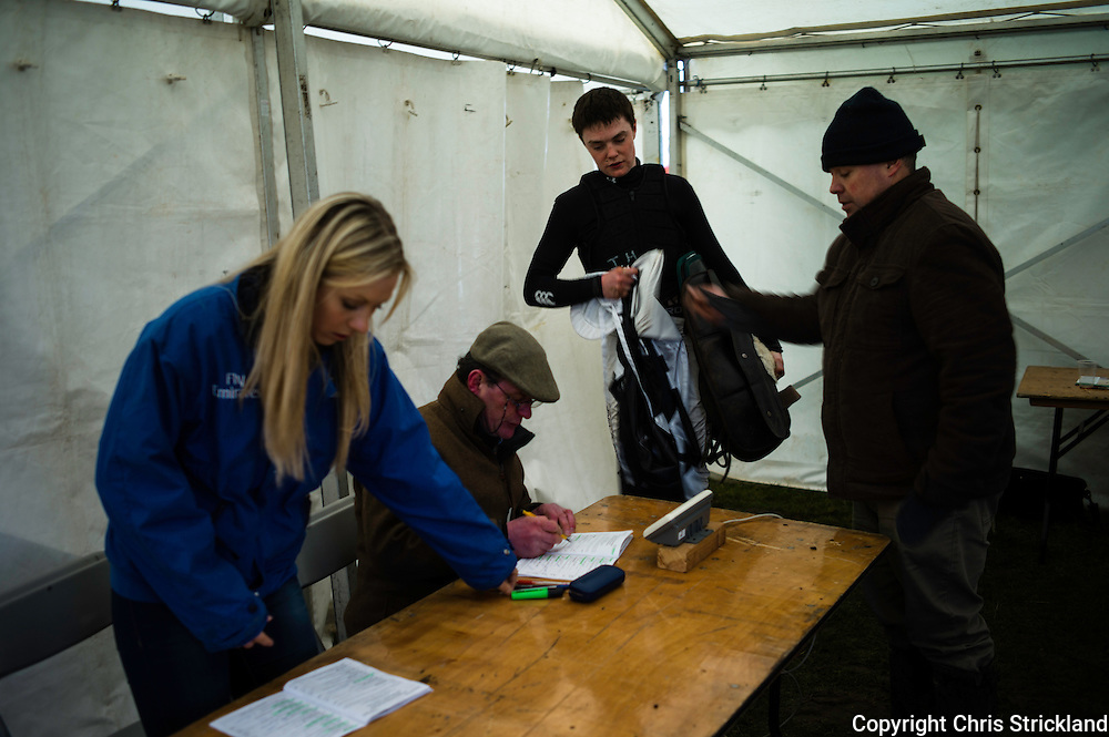 Andrew Robson weighs in the jockeys during point-to-point racing at Friars Haugh.