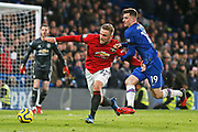 Chelsea midfielder Mason Mount and Manchester United defender Luke Shaw compete for the ball during the Premier League match between Chelsea and Manchester United at Stamford Bridge, London, England on 17 February 2020.