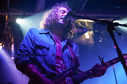 "© Licensed to London News Pictures. 22/3/14 London, UK.   The War on Drugs performing live at Corsica Studios. In this picture - Adam Granduciel.  The War on Drugs this week enjoyed excellent reviews for their third album ""Lost in the Dream"" released this week and are due to tour the UK in May.  Pitchfork rated the album 8.8/10; The Guardian reviewed the album 4/5; NME rated the album 9/10;  Drowned in Sound rated the album 8/10.   FILE IMAGE TAKEN 27/9/11.  The War on Drugs are a rock band comprising of members Adam Granduciel, David Hartley, Robbie Bennett, Patrick Berkery.  Photo credit : Richard Isaac/LNP"
