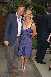 The MARQUESS & MARCHIONESS OF MILFORD HAVEN at the Tatler Summer Party in association with Moschino at Home House, 20 Portman Square, London W1 on 29th June 2005.<br />